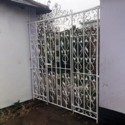 White Wrought Iron Courtyard Gates